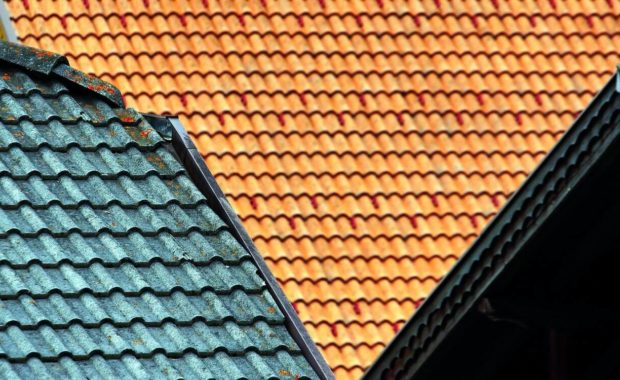 colorful roof shingles laid by roofing companies