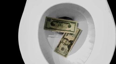 cash in a toilet saved by hiring Cincinnati plumbers