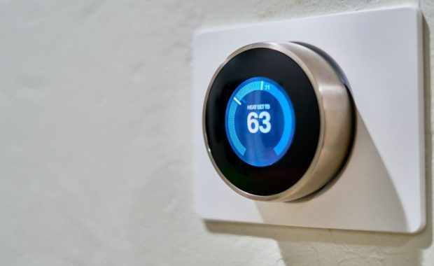 home thermostat operated by an HVAC service