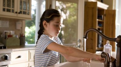 child using a sink installed by plumbers in omaha